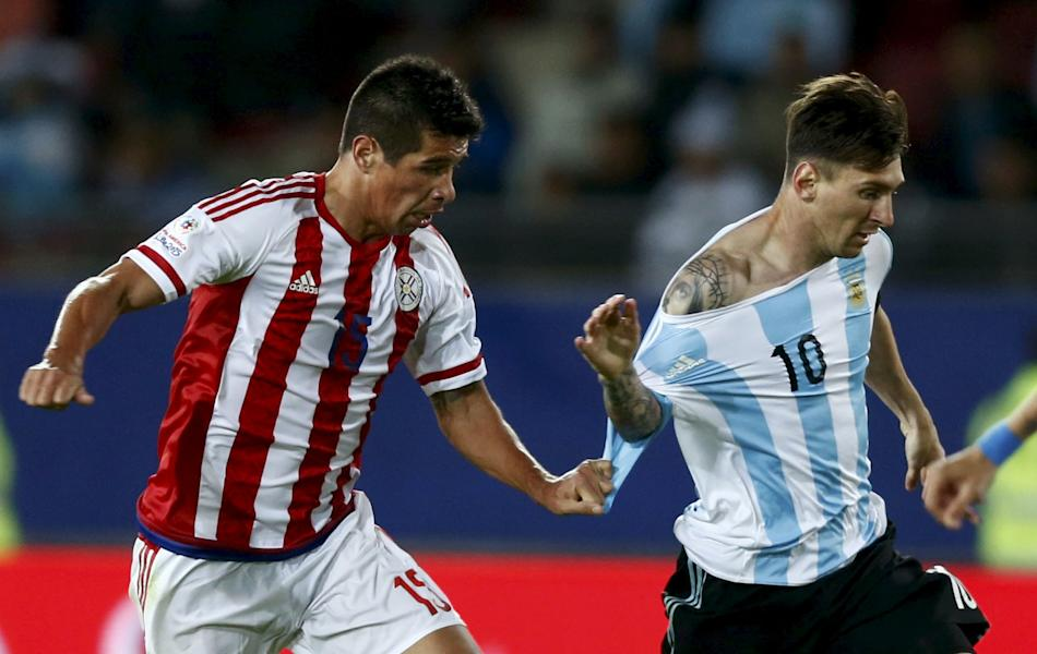 Paraguay's Caceres fouls Argentina's Messi during their first round Copa America 2015 soccer match at Estadio La Portada de La Serena in La Serena