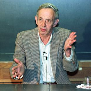 "FILE - In this Oct. 11, 1994 file photo, Princeton University professor John Nash speaks during a news conference at the school in Princeton, N.J., after being named the winner of the Nobel Peace Prize for economics. Nash, whose struggle with schizophrenia was chronicled in the 2001 movie ""A Beautiful Mind,"" died in a car crash along with his wife in New Jersey on Saturday, May 23, 2015, police said. (AP Photo/Charles Rex Arbogast, File)"