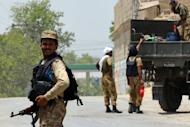 Pakistani soldiers heading towards North Waziristan are pictured by a road in Bannu district, on June 16, 2014