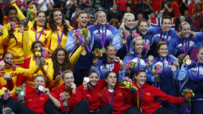Medallists from Norway, Montenegro and Spain pose during the victory ceremony for the women's handball final during the London 2012 Olympic Games