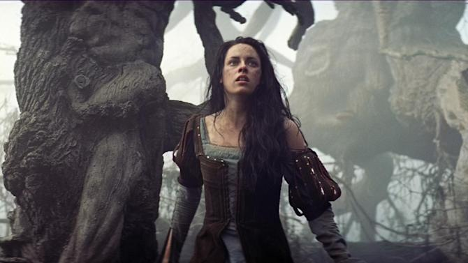 "FILE - This publicity film image released by Universal Pictures shows Kristen Stewart in a scene from ""Snow White and the Huntsman."" A follow-up to ""Snow White and the Huntsman"" is moving forward, though it's still unclear if Kristen Stewart will return as the warrior princess. Universal Pictures Chairman Adam Fogelson says the studio is aiming for a 2015 release on the sequel to last year's fairy-tale action story. (AP Photo/Universal Pictures)"