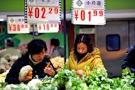 Shoppers buy vegetables at a supermarket in Hefei, east China's Anhui province. The Rome-based FAO's Food Price Index averaged 212 points in 2012, a drop of 7.0 percent owing largely to falls in the prices of sugar, dairy products and oil.