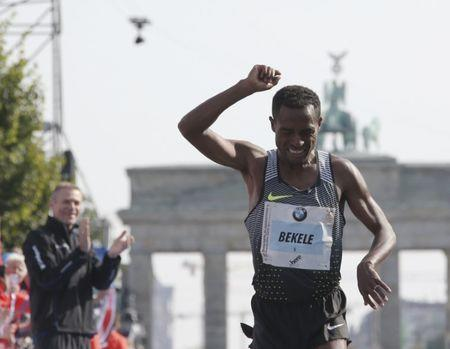 Bekele of Ethiopia celebrates winning the men's competition at the Berlin marathon in Berlin