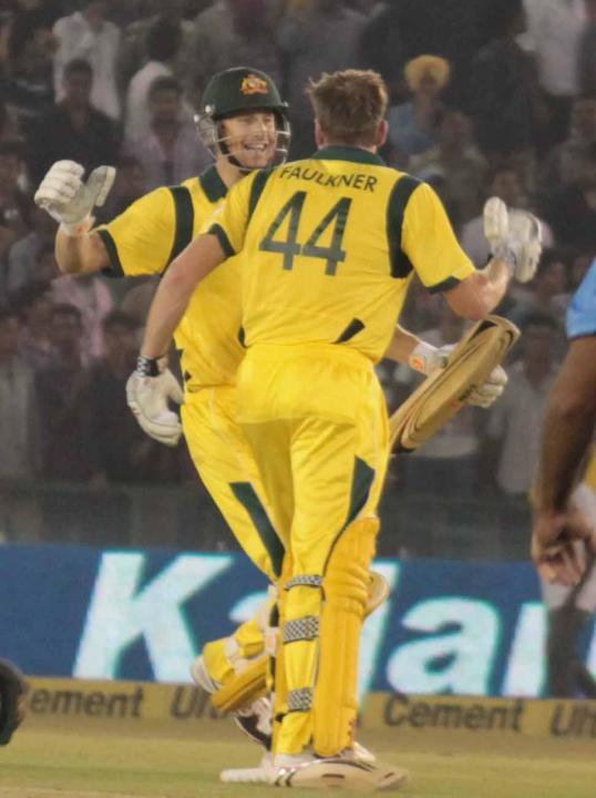 AC Voges hugs JP Faulkner after winning the 3rd ODI between India and Australia at Punjab Cricket Association Stadium, Mohali, Chandigarhon Oct. 19, 2013. (Photo: IANS)