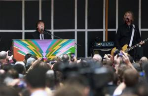 Paul McCartney gestures as he plays surprise mini-concert in New York's Times Square