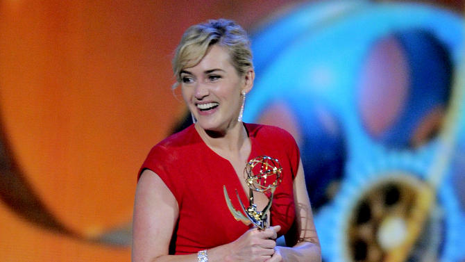 """FILE - In this Sept. 18, 2011 file photo, Kate Winslet accepts the award for outstanding lead actress in a mini-series or movie for """"Mildred Pierce"""" at the 63rd Primetime Emmy Awards in Los Angeles. The Academy of Television Arts & Sciences said Thursday, May 31, 2012 that it will merge the leading and supporting acting categories for such longform programming. Starting with the 2013 awards, new categories for outstanding actor in a miniseries or TV movie and outstanding actress in a miniseries or movie will each include six nominees. Previously, the four movie and miniseries acting categories included five nominees. (AP Photo/Mark J. Terrill, file)"""