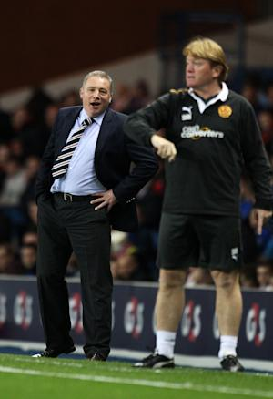 Ally McCoist, left, insists Rangers have a long way to go despite beating Motherwell