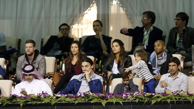 Paris Saint Germain soccer player Ibrahimovic watches the tennis match between Rafael Nadal and Tobias Kamke during their Qatar Open tennis match in Doha