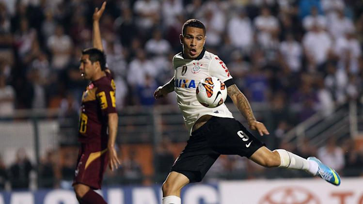 In this April 10, 2013 file photo, Paolo Guerrero, of Brazil's Corinthians, shoots to score against Bolivia's San Jose during a Copa Libertadores soccer match in Sao Paulo, Brazil. There will be plenty of talented foreigners in this year's championship, with Gremio leading the way with Hernan Barcos or Argentina, Cristian Riveros of Paraguay, Eduardo Vargas of Chile and Uruguay's Maxi Rodriguez. Rival International is led by Andres D'Alessandro of Argentina, while Palmeiras has Chile playmaker Jorge Valdivia and Fluminense has midfielder Dario Conca. Corinthians counts on Peru striker Paolo Guerrero, Botafogo has Uruguayan striker Nicolas Lodeiro and Sao Paulo will be relying on Dorlan Pabon of Colombia and Alvaro Pereira of Uruguay