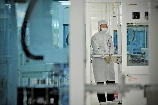 A worker monitors the production of solar cells in Changzhou