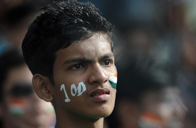 A dejected fan reacts after Indian batsm