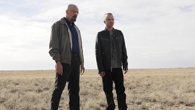 "This image released by AMC shows Bryan Cranston as Walter White, left, and Aaron Paul as Jesse Pinkman in a scene from the season 5 premiere of ""Breaking Bad.""  James Gandolfini's portrayal of Tony Soprano represented more than just a memorable TV character. He changed the medium, making fellow antiheroes like Walter White and Don Draper possible, and shifted the balance in quality drama away from broadcast television.  (AP Photo/AMC, Ursula Coyote)"