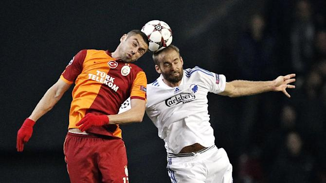 Galatasaray AS's Burak Yilmaz, left, and FC Copenhagen's Olof Melberg of Sweden during their Champions League Group B soccer match at Parken Stadium, Copenhagen, Denmark, Tuesday Nov. 5, 2013