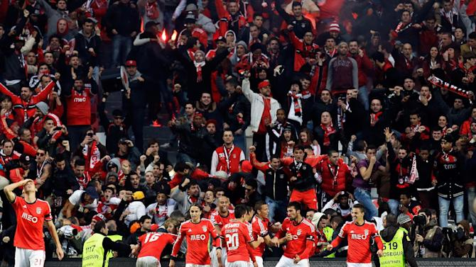 Benfica's Ezequiel Garay, from Argentina, 2nd right, celebrates after scoring their second goal during their Portuguese league soccer match with Porto Sunday, Jan. 12 2014, at Benfica's Luz stadium in Lisbon. Benfica defeated Porto 2-0 to take the lead of the championship
