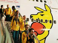 Australian Olympians disembark from a Qantas 747-400 plane inside a hangar at the Sydney Domestic Airport on August 15, 2012. Recriminations have begun in Australia after they finished only 10th at the London Games, down from sixth in Beijing, with just seven golds for their worst victory tally in 20 years