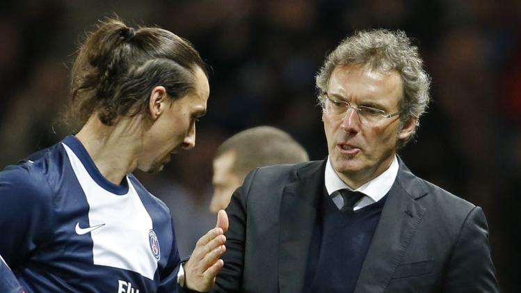 Paris Saint Germain's coach Laurent Blanc congratulates Zlatan Ibrahimovic as he returns to the bench during their French Ligue 1 soccer match against Valenciennes at Parc des Princes Stadium in Paris