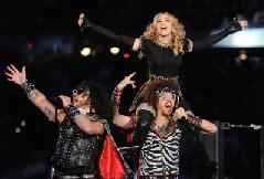 Madonna performs with LMFAO members Sky Blu and Redfoo during the Bridgestone Super Bowl XLVI Halftime Show at Lucas Oil Stadium in Indianapolis, Indiana on February 5, 2012 -- FilmMagic