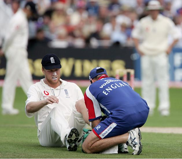 NOTTINGHAM, UNITED KINGDOM - AUGUST 28:  Andrew Flintoff of England receives treatment after hurting his knee during day four of the Fourth npower Ashes Test between England and Australia on August 28