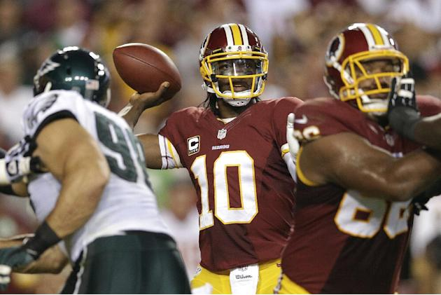 Washington Redskins quarterback Robert Griffin III (10) passes the ball during the first half of an NFL football game against the Philadelphia Eagles in Landover, Md., Monday, Sept. 9, 2013. (AP Photo
