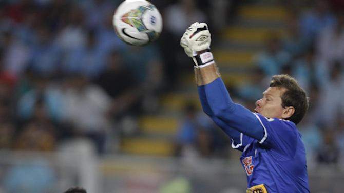 Peru's Sporting Cristal goalkeeper Diego Penny punches the ball against Brazil's Atletico Paranaense during a Copa Libertadores soccer match in Lima, Peru, Wednesday, Jan. 29, 2014
