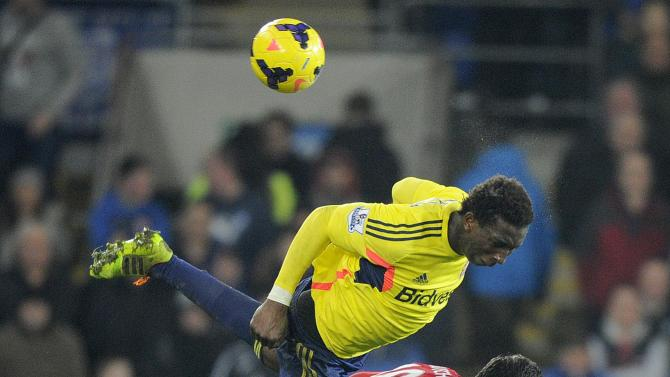 Cardiff City's Mutch challenges Sunderland's Diakite during their English Premier League soccer match in Cardiff