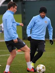 "Manchester City's James Milner (L) and Carlos Tevez during a team training session on November 20. ""We need to take our chances. We had a number of corners (against Chelsea) and chances that didn't go our way,"" Milner said"