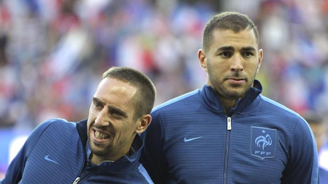In this Aug.15, 2012 file photo, French forwards Franck Ribery, left, and Karim Benzema, are seen prior to their friendly soccer match against Uruguay, in Le Havre, north western France. Bayern Munich winger Franck Ribery and Real Madrid forward Karim Benzema have been acquitted on charges of soliciting an underage prostitute as the judge ruled Thursday, Jan.30, 2014 there wasn't enough proof the men were aware that self-described escort Zahia Dehar, now 21, was a minor at the time