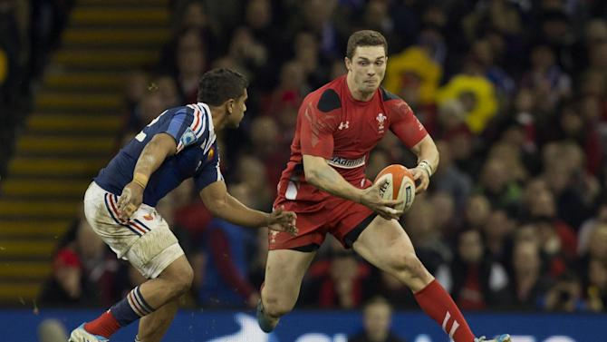 Wales' George North, right, keeps the ball from France's Wesley Fofana during their Six Nations rugby union international match at the Millennium Stadium, Cardiff, Wales, Friday, Feb. 21, 2014. (AP Photo/Jon Super)