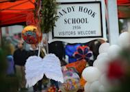 A pair of angel wings and balloons are left at a makeshift shrine to the victims of a elementary school shooting in Newtown, Connecticut, December 16, 2012. Nine-year-old Nicholas Sabillon was remarkably composed as he recounted how the Connecticut gunman who killed his schoolmates pounded on the locked door of the room where he was hiding