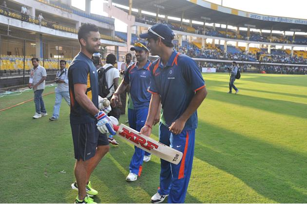 Virat Kohli with Bhuvneshwar Kumar, R Vinay Kumar during NKP Salve Challenger Trophy between India Blue and Delhi at Holkar Cricket Stadium in Indore on Sept. 26, 2013. (Photo: IANS)