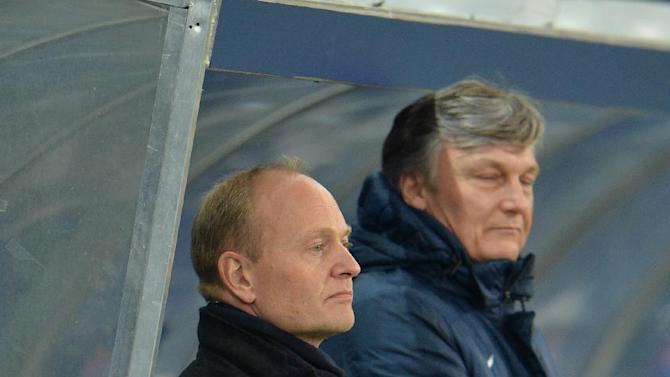 Esbjerg's  head coach Nils Frederiksen, left, looks  on prior to the Europa League group C soccer match  between Red  Bull Salzburg and Esbjerg fB  in Salzburg , Austria, Thursday, Dec  12, 2013