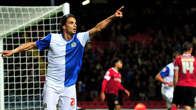 Nuno Gomes wheels away after his late goal kept Blackburn top of the table