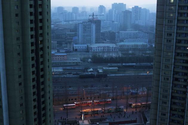 This April 12, 2011 photo shows central Pyongyang, North Korea at dusk through a hotel room window. (AP Photo/David Guttenfelder)