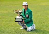 This handout photo provided by OneAsia shows Kim Bi-O of South Korea posing with the winner's trophy during the 31st GS Caltex Maekyung Open Golf Championship at the Nam Seoul Golf and Country Club in Seoul