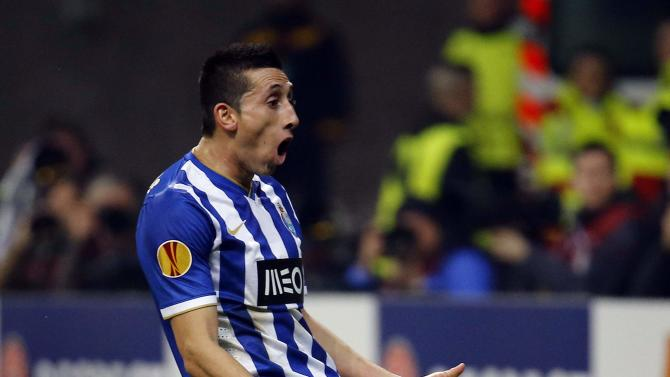 Porto's Hector Herrera reacts after missing a chance to score against Eintracht Frankfurt during their Europa League soccer match in Frankfurt