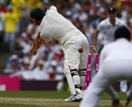 Australia's David Warner is bowled out by England's Stuart Broad during the first day of the fifth Ashes cricket test match in Sydney January 3, 2014. REUTERS/David Gray