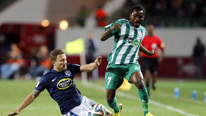 Kanda of Raja Casablanca fights for the ball with Auckland City FC player during their FIFA Club World Cup soccer match at Agadir Stadium in Agadir