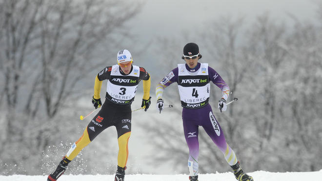 Akito Watabe Of Japan (R) And Tino Edelmann Of Germany Compete AFP/Getty Images