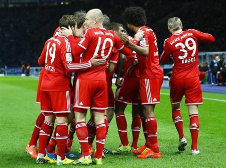 Bayern Munich players celebrate a goal by Toni Kroos (R) during their German first division Bundesliga soccer match against Hertha Berlin in Berlin March 25, 2014. REUTERS/Kai Pfaffenbach