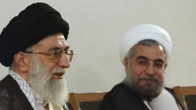 "In this photo taken on Sunday, June 16, 2013, and released by the official website of the Iranian supreme leader's office, supreme leader Ayatollah Ali Khamenei, left, speaks during his meeting with President-elect Hasan Rowhani in Tehran, Iran. On Sunday, Rowhani had his first meeting as president-elect with Khamenei, who offered ""necessary guidelines"" to him, state TV said, without elaborating. (AP Photo/Office of the Supreme Leader)"