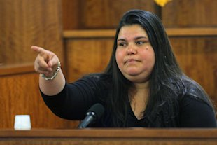 Housecleaner Carla Barbosa points to Aaron Hernandez as she testifies. (AP)