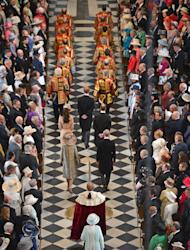 Britain's Queen Elizabeth II, foreground centre, arrives inside St Paul's Cathedral for a service of thanksgiving during Diamond Jubilee celebrations on Tuesday June 5, 2012 in London. (AP Photo/Jeff J Mitchell, Pool)
