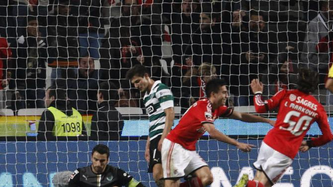 Benfica's Nicolas Gaitan celebrates his goal against Sporting with teammate Lazar Markovic near Sporting's goalkeeper Rui Patricio during their Portuguese Premier League soccer match at Luz stadium in Lisbon