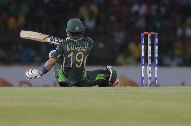Pakistani batsman Ahmed Shehzad loses his balance while playing a shot during the first Twenty20 cricket match against Sri Lanka in Colombo, Sri Lanka,Thursday, July 30, 2015. (AP Photo/Eranga Jayawar