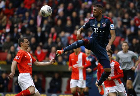 Bayern Munich's Jerome Boateng challenges Zdenek Pospech of FSV Mainz 05 during their German first division Bundesliga soccer match in Mainz