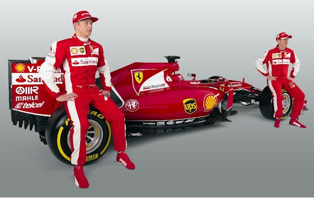 The new Formula 1 Ferrari team with Kimi Raikkonen (L) and four-time world champion Sebastian Vettel, who makes his debut for the team as the 20-race season kicks off at Melbourne's Albert Park ci