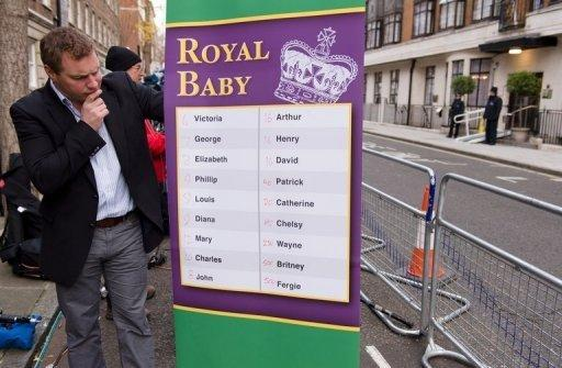 A bookmaker poses with a list of possible names for the baby of Catherine, Duchess of Cambridge, wife of Prince WiIliam, outside King Edward VII hospital in London, on December 6, 2012. Bookmakers say they expect that wagers on the arrival of Prince William and Catherine's first child will outstrip those for the couple's wedding in 2011, previously the biggest market for so-called novelty bets