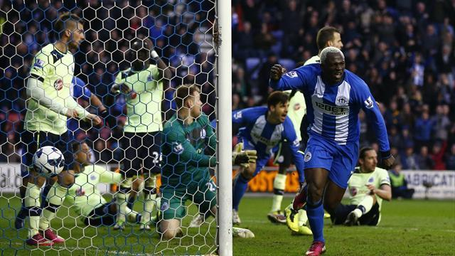 Premier League - Late Kone strike snatches contentious Wigan win