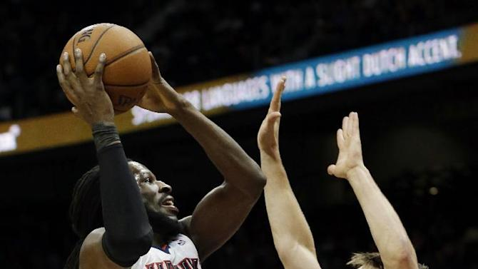 Atlanta Hawks small forward DeMarre Carroll (5) goes to the basket as Cleveland Cavaliers shooting guard Matthew Dellavedova defends in the first half of an NBA  basketball game Friday, Dec. 6, 2013, in Atlanta