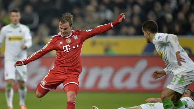 Bayern's Mario Goetze kicks the ball during the German Bundesliga soccer match between Borussia Moenchengladbach and Bayern Munich in Moenchengladbach, Germany, Friday, Jan. 24, 2014. (AP Photo/Martin Meissner)